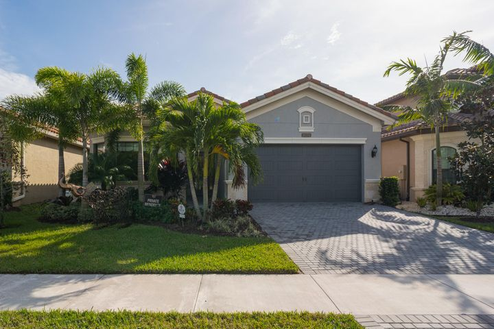 This gorgeously appointed 4BR/3BA + den 1-story  open and spacious home has every quality upgrade you could want and is located in the highly sought after community of Seven Bridges. Desirable features of this split-plan home include volume ceilings, herringbone pattern wood-look tile throughout, large windows and sliding glass doors with motorized shades, an open-concept kitchen with high-end stainless steel appliances and a large island with a snack bar, an electric in-wall fireplace, a whole house generator, surround sound inside and out, custom built-in closets, and professional landscaping with lighting. The patio is pre-wired for a pool. Full impact windows throughout. SELLER MOTIVATED! LOWEST PRICE IN SEVEN BRIDGES! NOTE: All brokers and buyers wanting to see the property for showings and Open Houses MUST call Listing Agent to be added at gate for entry prior to coming to property.