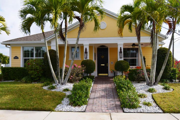 GORGEOUS!  PROFESSIONALLY DECORATED AND DESIGNED, THIS HOME IN BEDFORD PARK IS A MUST SEE TO TRULY APPRECIATE THE CREATIVITY IN DECOR. BOLD COLORS AND DISTINCTIVE LIGHT FIXTURES HIGHLIGHT THE OPEN LAYOUT, FAMILY ROOM AND DINING AREA. DINING ROOM FEATURES WALL MOUNTED FISH TANK!  WOOD PLANTATION SHUTTERS ENHANCE THE WINDOWS WITH DIAGONAL TILE AND BEAUTIFUL WOOD FLOORS AND EXTENSIVE CROWN MOLDING.  KITCHEN FEATURES 42'' WOOD CABINETS, PULL OUT, STAINLESS APPLIANCES, POT FILLER FAUCET, WALL OVEN AND COOK ISLAND.  RELAX IN THE DEN WITH CUSTOM SHELVES AND BAR.  ENJOY THE TRANQUIL COVERED LANAI OR THE EXTENDED, FENCED PAVER PATIO, GAS COACH LIGHTS.  OVERFLOW KITCHEN IN GARAGE WITH AC!  RING, NEST SMART SYSTEMS, LIGHT DIMMERS.  TANKLESS GAS HOT WATER HEATER WITH CIRCULATING PUMP. CENTRAL VAC. ONLY LOT LOCATION ON CORNER INDEPENDENT OF OTHER HOMES. WALK TO COMMUNITY PARK. AFFORDABLE DUES INCLUDE FULL LAWN CARE, CABLE, INTERNET, COMMUNITY CLUBHOUSE WITH HEATED POOL. CLOSE TO ALL TRADITION HAS TO OFFER.