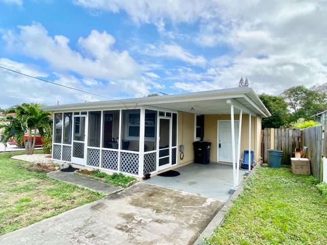 A quaint move-in ready home located in the heart of WPB. Easy access to I-95 and Downtown for the commuters. Completely remodeled kitchen with granite counter tops and new appliances in '18. New A/C installed in '18. Roof replaced in 2014. Home's layout feels much larger than the stated square footage. Real wood floors in great shape. Fully screened enclosed front porch catching the nice breeze from the East. Home faces North, so no direct sun on front or back porch. Large Wooden shed in back yard allows for lots of storage. Nice sized carport, Laundry Room with washer & dryer and space for extra storage. Fully fenced in yard for the pets. Home is currently occupied by a month to month tenant who is interested in staying in the home with new owners. No Homeowners association.