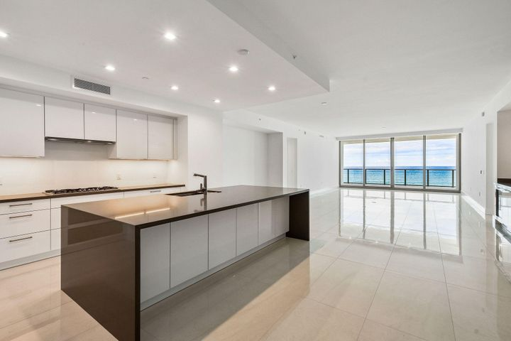 """Direct Atlantic Ocean views and pristine beach access from this brand new Singer Island address. Spectacular views make you think you have landed in Bermuda.The Beachwalk Model residence has over  45 ft of direct ocean views. This great room floor plan offers 2 spacious Bedrooms, a Den and 3 Baths. The Master includes an exceptional closet of 20x10 ft. High ceilings and floor-to-ceiling windows and sliders maximize the views and natural lighting. Over 500 sq.ft. of outdoor living space allows for direct ocean breezes and easy entertaining. Glass panel rails allow unobstructed water views. The designer kitchen features gorgeous German cabinetry by Nolte, the latest storage systems & integrated LED lighting. Quartz countertop with full-height backsplashes & large islands with waterfall edges. Thermador appliance collection, with 30' refrigerator column & 18"""" freezer column & Ice Drawer, gourmet 5-burner gas-cooktop with 36"""" retractable stain-less steel canopy hood, under-counter microwave drawer and Wine Cooler & beverage Center. Laundry Room with upper & lower European cabinets and large capacity Electrolux front load washer & dryer. Ultra, highspeed connectivity for easy custom home automation. Beautifully finished and delivered furniture-ready with an abundant choice of designer coordinated selections. The amenities of 5000 North Ocean offer sophisticated luxury living, oceanfront fitness center and resort-style pool."""