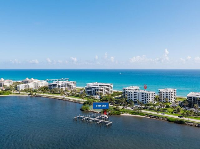 Apartment in an oceanfront building that lives like your own home on the beach. Includes your own boat slip! Impact window and doors!  Oasis is a boutique building in an amazing location.
