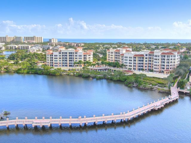 Rarely available one of a kind condominium directly on the intracoastal. This four bedroom , 4 1/2 bath home features over 2700 ft.A of private patio with direct intracoastal views!Over 3100 ft.A of air-conditioned luxury featuring private elevator, marble floors, chefs kitchen, open floor plan, walk in closets, spa like baths, garage parking & more!   Large deeded dock also available. (44 x 18.5' dock holds up to a 49 foot vessel and is offered separately)Jupiter Yacht Club offers the convenience of city living right on the beautiful intracoastal. 24 hour manned security guard gate, clubroom, pool, fitness center, billiards, on site manager and extra storage.