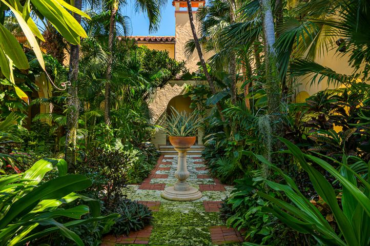 Bienestar, Palm Beach's hidden gem.The moment you enter the courtyard of Bienestar you are transported to the tropical paradise of old Palm Beach.  One of only two grand mansions which have been converted to a condominium, Bienestar is a 1924 Marion Sims Wyeth home, located at the end of a private road behind the St Edwards Parish Center.   Renovated and expanded in the mid 1980's, the structure is landmarked.  Unit 4 is the largest of the 6 units with 2,701 SF of living space.  Featuring 3 bedrooms and 3 baths with full-run front and rear loggias, the property offers expansive interior and exterior entertaining spaces.  The Sellers undertook an extensive renovation in 2014 to bring the space up to current code including, replacing the AC, hot water heater, all electrical and wiring, replacing the 3 bathrooms and the kitchen, restoring moldings, custom casework and installing a new bar and laundry.   The location can't be beat.  Walk to Amici, Greens, Chez Jean Pierre, Trevini and Publix or any of the local merchants within a 2-block walk.  Or if you prefer, walk a ½ a block down Root Trail to beach access, 3 blocks to The Royal Poinciana Plaza, or the Breakers!   More importantly, Unit 4 is perfectly situated on the property by the pool, the garage and the Tea House and south lawn.  The full-time property manager offers owners a turn-key lifestyle whether they are year-round or seasonal.   This is one of the best kept secrets and most unique condominium properties in Palm Beach.  Not to be missed.