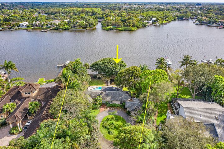 Don't miss this exceptional Pennock Point, .91 acre, estate property.  Southern exposure, sought after Pennock Point Road, tropical landscaping and endless views of the Loxahatchee River.  Enjoy the charming three bedroom, three bath, pool home or build the home of your dreams.