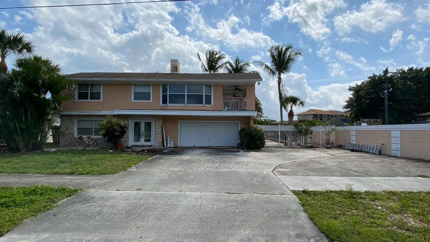 HUGE PRICE REDUCTION. BRING ALL YOUR OFFERS TODAY!!!!LOCATION, LOCATION,LOCATON!! THIS IS ONE OF THE KIND!! This amazing property is centrally  located in a premium location in the Jupiter area close to the beach.  This property features 4 bedroom and 3 bathroom. 2 kitchens one is upstairs and one is downstairs. 2 A/C units were replaced 1.5 year ago. Water water was replaced 4 months ago. Dishwasher and stainless steel refrigerator were replaced 1 year ago. Swimming pool, BBQ area,  built in Jacuzzi tub, and a very spacious terrace.  Huge driveway with plenty of space for your boat and trucks. This property need some love and to be clean up for the next family. SUPER RARE TO FIND PROPERTY REQUEST A SHOWING TODAY!!