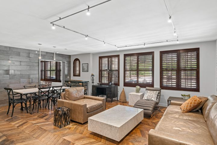 Rare opportunity to own the largest unit in the prestigious Brazilian Court. This ground floor unit has been totally renovated by David Lawrence Architecture and AMC Builders. Premium custom features include: herringbone reclaimed oak  and  French limestone flooring - both over 200 years old. Also, custom concrete counter tops in all bathrooms, and solid wood plantation shutters. Enjoy a private courtyard off the master and guest bedroom, washer/dryer in unit and all the hotel amenities! Brazilian Court is a full service, pet friendly building with endless amenities including 24 hr. front desk, dry cleaning, fitness center, salon, car service and internationally acclaimed Chef David Boulud's restaurant Cafe Boulud. Walk to restaurants, shops, the ocean, and the marina.