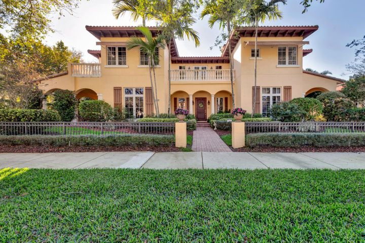 Frankel Paone Quality Built 2002. CBS Construction, Vizcaya Model, Mediterranean Style, corner lot with front views of green space. East front exposure, South pool exposure. Lot measures 98 x 136 FT, .30 Acres, Fully Fenced. 5 Bedroom, 4.5 Bath, Den, 3 Car Garage, Pool. Barrel Tile Roof, 6,205 Total Sq. Ft, 4,484 A/C Sq. Ft, full house hurricane shutters. (3) Total A/C Units, (2) 2011 (1) 2012 and Tankless water heater. First floor laundry room, paver brick, covered entry. Travertine and hand scrapped hardwood floors throughout main level. Second floor has oak hardwood floors. Living Room has marble inlay and flooring, volume ceilings, recessed and chandelier lighting, built in wood cabinetry with marble countertops and a gas fireplace with marble inlay and wood mantle. Formal dining room has marble floors, crown molding, recessed and chandelier light, private access to outdoor covered lanai.The Kitchen has an open concept living to a breakfast nook and family room. The Kitchen offers a full complete of stainless steel appliances, including a double wall oven, wood cabinetry, granite countertops and a large reach in pantry. There is also a desk area with cabinetry. The breakfast nook looks out to the pool and has a chandelier light. The family room has marble inlay and flooring, recessed and fan lighting, built in wood cabinetry and access to the outdoor covered lanai.  First floor master suite has hand scrapped hardwood floors, recessed and fan lighting, walk in his and hers closets, private access to the outdoor patio and pool. Master Bathroom has oversized shower, separate jetted tub, his and hers vanities, granite countertops, wood cabinetry, and a separate water closet.The first floor also features an Office/Den with wood floors, fan with lighting, and private access to a covered lanai.  Second floor has four guest bedrooms and has been used minimally. Guest bedroom 1 has oaks floors, plantation shutters, crown molding and a reach in closet with shelving. Guest bedroom 2 has oak floors, plantation shutters, fan lighting, crown molding, walk in closet with shelving, and access through pocket doors to guest bathroom. The guest bathroom has a shower with seamless glass shower doors, single vanity with marble countertops, wood cabinetry and chandelier lighting. Guest bedroom 3 and 4 have their own ensuite Bathroom with tub and shower combo, single vanity with marble countertops and wood cabinetry. Both ensuites have a walk in closet and Guest Bedroom 3 has access to its own private balcony.  Powder room is located on the first floor. The backyard has privacy landscaping and wall, inground chlorine pool and a covered paver lanai. Valencia is located in Abacoa, a vibrant community with a clubhouse, parks, walking trails, minutes from dining, entertainment, Roger Dean Stadium, close to I95 and major highways.