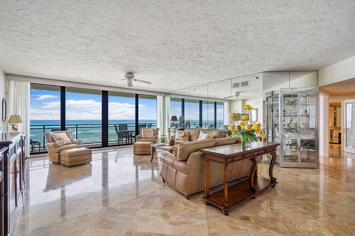 Remarkable direct oceanfront 3 bedroom - 3 bath with unobstructed ocean views from every room. Beautiful marble flooring flows thru the living areas and the newly renovated kitchen and bathrooms. Inside you will find 8'10'' ceilings, new hurricane impact doors and windows and many custom features. The Hampton has undergone a $12.5 million beautification and capital improvement. The Seller has paid $83,066.11 for the first $7.5 million loan. There are 2 remaining loans totaling $5.05 million with monthly payments of $649.45. This loan sunsets in the 4th 1/4 of 2029 or the Buyer can pay off the principal in 10/2020 which is approximately $56,000. Enjoy the Palm Beach Lifestyle and all the amenities in this Pet Friendly Luxury Oceanfront Building.