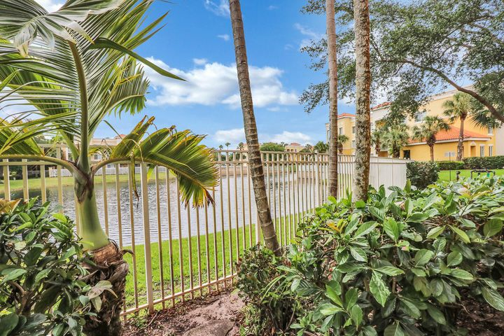 FURNISHED OFF SEASON RENTAL ONLY- Available May 1, 2020-December 31, 2020. Come Enjoy this Beachy First Floor Condo in the Heart of Palm Beach Gardens! 2 Bedrooms, 2 Full Bath + 2 Parking Spaces. Hurricane Impact Windows & Sliders. Nice Lake Views. Hardwood Flooring Throughout. Nice Small Patio off Kitchen. Lake Views from Bedroom, Dining, Living Room & Kitchen. Laundry Room Inside. Stainless Steel appliances w/ Granite Counter Tops in Kitchen & Baths. Legacy Place is a Gated Community, Located in a highly desirable area just seconds from fine dining & shopping, Publix Greenwise, Gardens Mall & Downtown at the gardens. Resort like amenities include: gym, pool, tennis courts, playground.