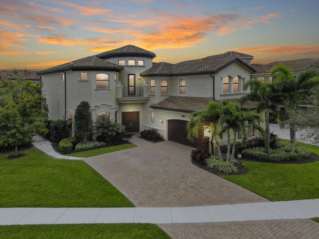 This extraordinary offering presents 3,926 square feet designed to awe the most discriminating buyers. The gourmet kitchen will inspire your inner chef with its top of the line stainless steel appliances, 5 burner gas stove, double oven, granite countertops, full granite backsplash, under and above cabinet lighting and large center island. The divine master retreat presents a coffered ceiling and his and hers custom walk-in closets. The opulent master bath features framed mirrors and granite countertops. Relax on the back patio overlooking your resort style heated salt water pool with a fountain and a large private yard with a gas fire pit and tropical landscaping. Spectacular summer kitchen with a snack bar, 4 refrigerators, 2 sinks, an ice maker and built-in grill with 2 side burners. The Bridges provides first class amenities that include a clubhouse, fitness center, yoga studio, saunas, indoor sports courts gaming room and children's center. Relax by the resort style pool or the kids aqua lot. The Bridges offer tennis facilities that include Har-tru and hard courts.