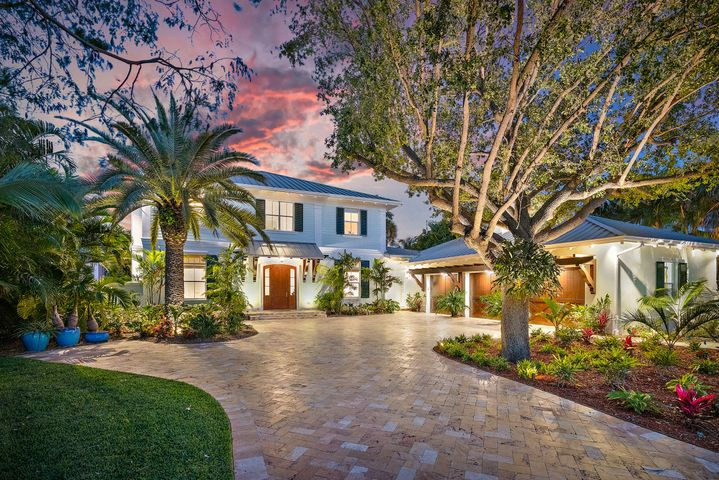 This British West Indies inspired masterpiece  is situated on an oversized estate lot on one of the best streets in the area. Located in a No Wake zone the dock has a 16,000lb and a 10,000lb lift. The dock can be altered to accommodate a large Sportfish. This tropical paradise has over 70 species of Palms, East exposure, a resort style pool and a 48KW whole house generator with 1,000ga propane tank. Built by noted builder G W Purucker Homes this home has full two-story CBS construction, a concrete slab second floor and a standing seam aluminum roof. The Chef's kitchen offers an abundance of counter space, Wolf and Subzero appliances and a gas cook top and oven.