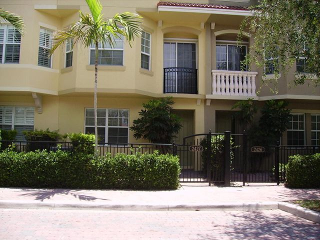 Townhouse with direct lake views, 2 BR plus bonus room on first level, could easily be a bedroom, office or den, upgrades included stereo intercom, security system, diagonal tile, granite kitchen counters, new refrigerator, AC 2019, gorgeous club house and pool, fitness room, picnic area, great location, close to mall and beach