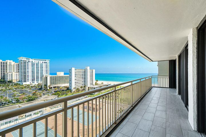 Ocean and City Views! The Best of both Worlds on the Famous Singer Island! This 2 Bedroom, 2 Bath unit has breathtaking views from wrap-around balcony on the 12th floor of the OceanTree Condominium! Impact Windows and recently updated! Some photos are virtually staged. Unit is available for immediate occupancy! Enjoy amazing direct Beach front Access along with amenities including: 2 Swimming Pools, Spa, Tennis, Exercise Room, Saunas, Bocce Ball Court and Community Room with Catering Kitchen for Events! 24Hr Manager on staff. Walking distance to Restaurants, Shopping and more!!!