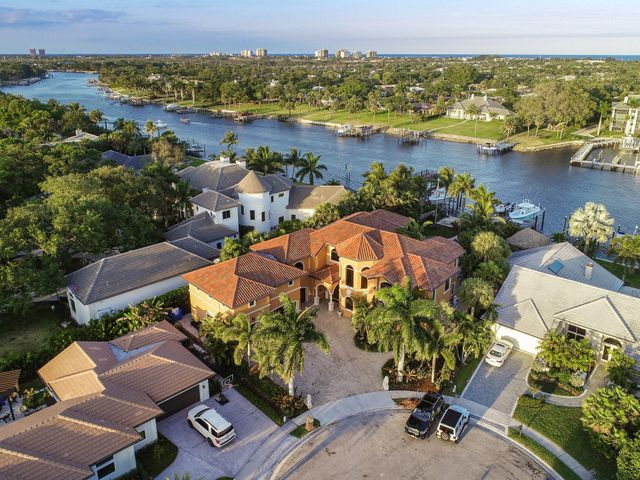 This elegant intracoastal estate, located in a no wake zone is a thoughtfully designed home brimming with modern conveniences. Boasting ocean access, this 5-bedroom, 7-bath estate is suited to an active Florida lifestyle. Inside, find Turkish limestone floors, a spacious gourmet kitchen with mahogany cabinets, granite countertops and Thermador appliances. Out back is a temperature-controlled saltwater pool and a waterfall spa. Additional amenities include an elevator, a full-house generator, multi-zone air conditioning, a garage with space for 6 vehicles plus extra storage for water toys and a dock with two boat lifts (22,000 lb and 14,000 lb lifts) and an Ipe deck.