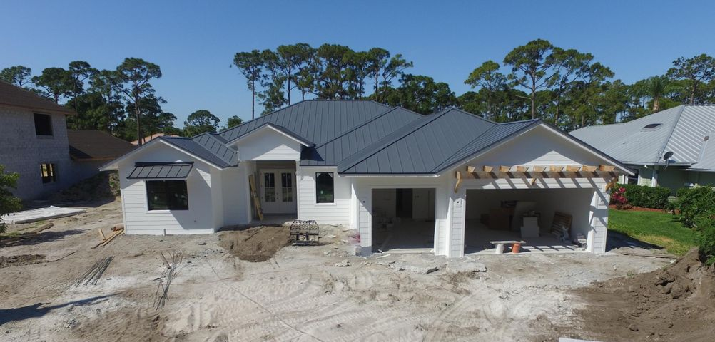 New Construction!!! This one of a kind custom home will be ready early spring of 2020. Still have time to choose some of the finishes. It has 5 bed, 4 bath, and 3 car garage on a half acre lot in Jupiter, no HOA. It features a large great room open to the kitchen, dining and living room. Its inviting outdoor living space has a summer kitchen and a resort style pool with a sun shelf, and spa. The property has 100 ft of waterfront with a brand new dock. Ocean access with one fixed bridge, 12 ft clearance. The kitchen has a spacious island with custom white shaker cabinets, high end GE Monogram appliances, and gas range. Wide plank hardwoods throughout the main living space, and master bedroom. HURRY this home will not last!