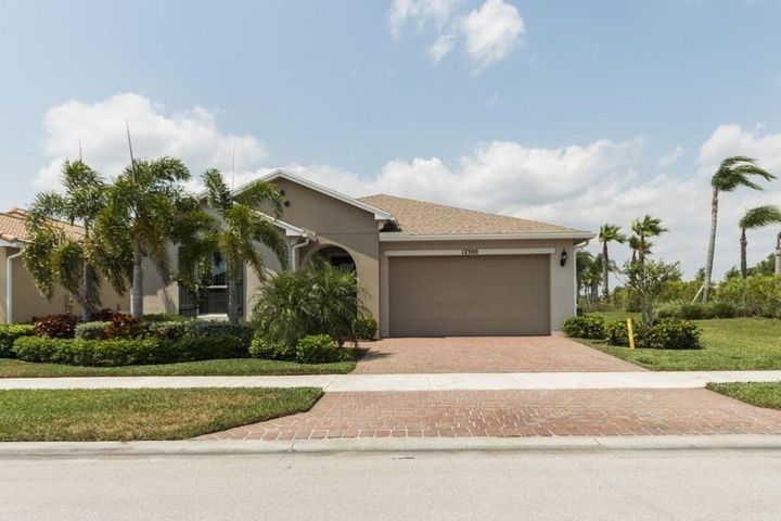 This incredible ''Estero'' model was built in 2017 in Vitalia at Tradition an active 55 plus community. There are 2 bedrooms and 2 baths plus a den. Enjoy a gourmet kitchen that boasts 42'' cabinets, granite countertops, Stainless steel appliances, gas cooktop and double in cabinet ovens. Relax on an extended screened lanai to enjoy wonderful sunsets overlooking a lake. There is a whole house emergency generator, high impact storm windows and doors, sealed garage floor, upper and lower laundry room cabinets, with upgraded tile in main living area. Residents enjoy full access to numerous Vitalia activities like card games, chess and movie nights in the grand ballroom along with many professional entertainment events in the clubhouse. Outside activities lets you enjoy a resort style pool and