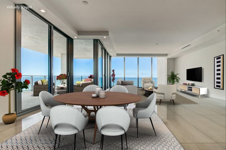 Brand new prestigious beachfront residence In Singer Island. Welcome home through your private foyer to this northeast corner unit with endless views of the ocean and intracoastal. Extended balcony perfect for entertainment and outdoor/indoor living. Top of the line finishes and materials through out. Oversized master suite complete with spa shower and dual sinks.