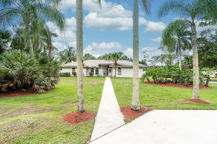 Sitting on 1.25 Acres,NO HOA,This Stunning & Beautifully Renovated CBS 4 Bedroom, 2 Bathroom, 2 Car Garage, Pool Home is in Jupiter Farms!! New 2018 A/C System,2006 Roof,2018 Water/Heater,All New 2018 Stainless Steel Appliances,2018 New Kitchen With New White Shaker Cabinets & Granite Countertops,New Backsplash,Renovated Bathrooms, All New Tile Flooring & Baseboards in Main Living Areas, New Vanities & Tubs, New Toilets,Mirrors & Shower Tile.New Laminate Flooring In All Bedrooms.New Interior Doors Throughout, All New Fans & Fixtures.2019 Washer,2017 Dryer,New Pool Equipment & Baby Fence, Great Large Lanai With New Outdoor Fans, New Water System.New Fence & Fully Fenced In, Back Paddock,New Yard Playset, Freshly Painted Interior & Exterior.Very. Close Proximity to Indiantown Rd. & Shops! **FULL HURRICANE COVERS**