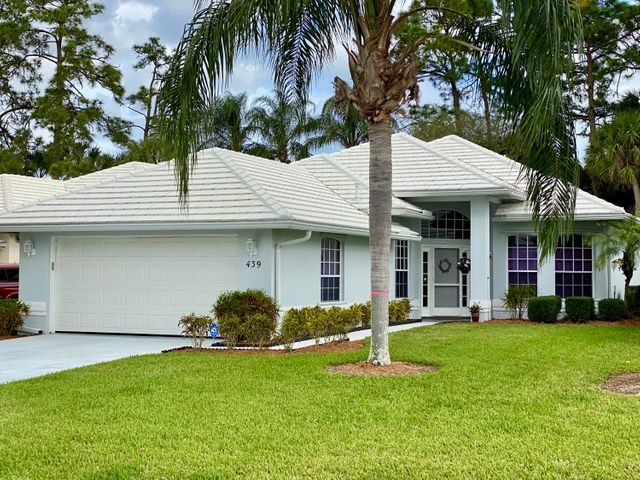 PRISTINE describes this gem of a house.  Renar built 2 bedroom 2 bath Split floor plan  home with a den situated on the St. Lucie Trail Golf Club course. This Florida Style home is appointed with Granite Countertops, newer appliances, newer Tile flooring, A/C Glassed in Sunroom,  4 year old roof,  Located in the Heart of St. Lucie West close to Shopping, Restaurants, Hospitals and I-95.  There are 2 HOA's Master Country Club (347.85) and Fairway Isles (360.00) paid Quarterly.  The HOA currently includes lawn, roof maintenance, and painting of the home. Owner did a preinspection on the home and report is in Documents. St.Lucie Trails offers several amenities (Pool, tennis, golf, etc..) to residents through optional reasonable membership rates