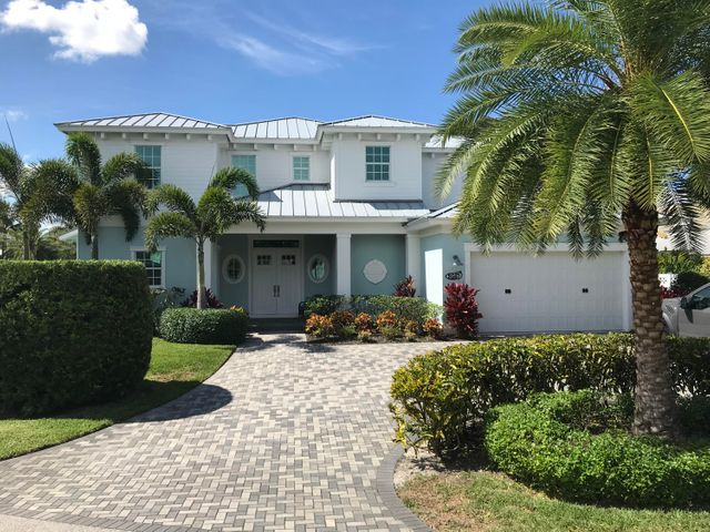 This beautiful WATERFRONT custom home built in 2017 is nestled on a quiet street with direct views of the Jupiter Sand Bar. This home is located minutes from the Jupiter Inlet and is perfectly set up for a dock and boat lift of your dreams. Dock has already been permitted. The Kitchen is complete with beautiful high end appliances including Kitchen-Aid Smart Commercial gas range, built in side by side refrigerator, wine fridge and double sinks. The living area and bedrooms offer breathtaking views of the water and Jupiter Sand Bar. This home features a separate entrance for bedroom 2 perfect for guests