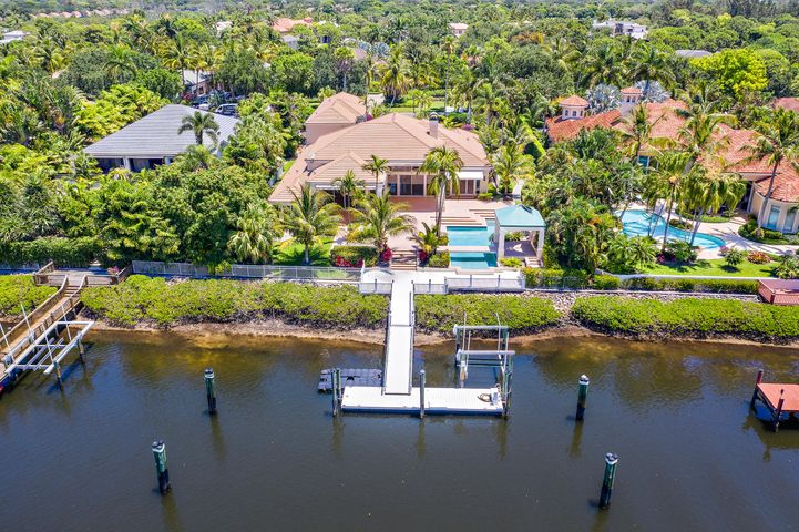 Vacant and Easy to Show!   This custom home has a Rare Social Membership in Admirals Cove.  The larger lot has 110 feet of waterfrontage perfect for a boater to have a larger vessel behind their home.   Easy access to the Intracoastal waterways.  The home has 5 bedrooms and 5 full baths and 2 half baths, 4 car garage, a theater room, and so much more.