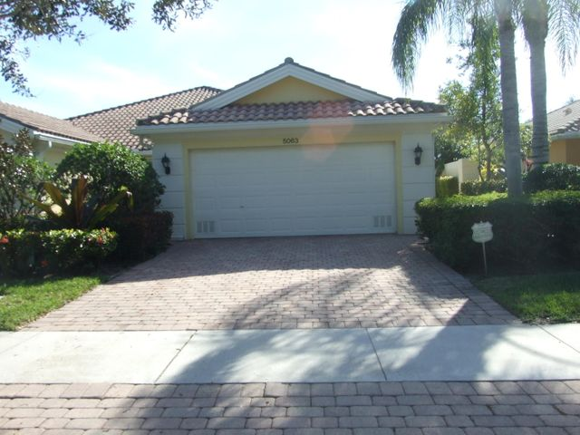 Available for off season rates. Beautiful Capri Model in Magnolia Bay, 2/2 with 2 car garage and large outdoor space. Serene, long lake views from your patio. Community pool, fitness center and tennis courts. Centrally located to beaches, shopping, highways and fine dining.