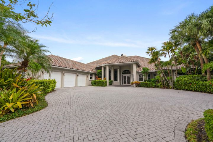 Location is the key!!!  4 bedroom 4 baths and 2 half baths, custom built in 1988.  4,000 sq. ft.  very neat and well kept home, could be an enjoyable update project.  A large open water view on a very desirerable street.  Just listed $2,550,000