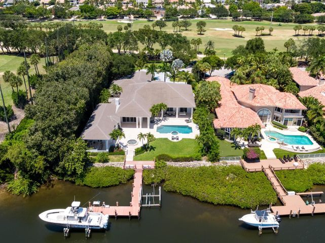 Waterfront state of the art ''smart home'' on oversized cul de sac lot featuring 120' of prime water and spectacular views. Huge master suite with his and her baths and custom closets plus 4 large bedroom suites w/full baths. Chef's kitchen with large quartz dine at island, modern top of line appliances, solid wood custom cabinetry and full built in bar. Amazing family room includes full bar, pool table, media system and full bath with steam shower. Summer kitchen features large counter, grill and pizza oven. Resort style pool/spa and patio includes a very large backyard and dock has 2 lifts and property can accommodate up to 65 feet.