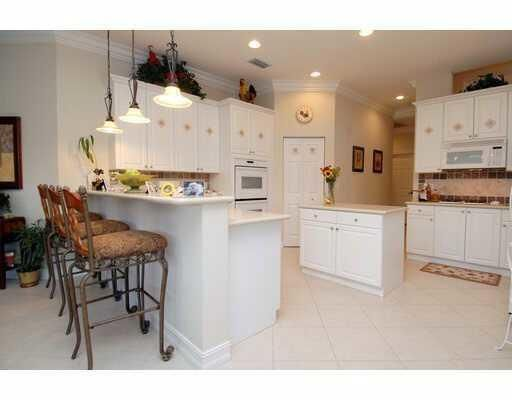 Beautiful Lakefront in a Gated Community!!!  Vaulted Ceiling, recessed lights, formal dining room, Office, screened pool.