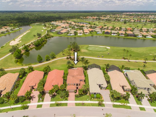 Live your best life in this highly sought after Santangelo model in the luxury resort-style community of Jupiter Country Club! This spacious floor plan boasts 4 BR, 3 1/2 BA + den. Step out from the open concept great room to the extended covered lanai into the outdoor oasis. Inviting & spacious, this area boasts a summer kitchen, motorized retractable screens, a salt chlorinated pool with a rock waterfall & a lushly landscaped view of the lake & golf course. Sunsets are enchanting from this relaxing outdoor living area! The downstairs master retreat has hardwood floors & 2 large walk in closets. BONUS: Since owner is a charter member, the next owner will enjoy a discounted initiation fee of $3k for the Club Membership ($2k savings) and $5,000 for the Full Golf Membership ($13,500 savings).