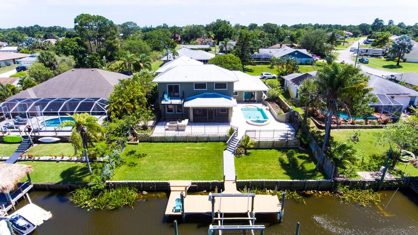 ABSOLUTELY AMAZING OCEAN ACCESS POOL HOME!!! This 2006 CUSTOM BUILT HOME, Boasts 5 Bedrooms, 3.5 Baths, and over 3500 sq.ft., Creating a TROPICAL OASIS That is Sure to Please Even the Most Discerning WATER LOVER! Located on a Wide Canal Just off the Main River, and Across From a Preserve, This Home Provides the Ultimate in PRIVACY and VIEWS!  No Expense was Spared in The Building of This Beauty, with Features such as: Poured Concrete Walls with Metal Roof, Impact Windows and Doors, Heated Pool with Coral Stone Deck, 2nd Story Loft w/ Fireplace and Balcony, Large Dock with PVC Decking,12,000 lb Boat Lift, Whole House Generator, 3 Zone A/C (2 New in 2018), RV PAD w/ Hook-ups, 2 Master Suites, Travertine Tiled Floors and Baths, and a CHEF'S KITCHEN that Would Make Wolfgang Puck Say WOW! Next Kitchen is Equipped with Custom Astra Cabinets, Sub-Zero Fridge, DCS Gas/Electric Stove, Pot Filler, and Granite Tops. Other Features include:Real Wood floors in Bedrooms, Trey Ceilings, Crown Molding, Pet Shower, Plantation Shutters, Bamboo Blinds, Circular Paver Driveway, Outdoor Kitchen, Irrigation System, and so Much More. Don't wait to See This Spectacular Home!