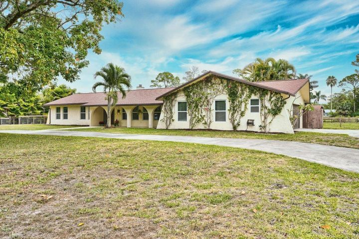 This equestrian dream home is on 2.5 acres, with plenty of horse trails across the street. It's freshly painted and waiting for the new owners to call home. The home features a barn (built in 2016). The barn has 6 12x12 stalls (can be easily made into 8-9 stalls), w/electric, water, fans, feed /tack room, generator and is already hooked up for a fly system. The wash rack on the side of the home has hot and cold water running to it. The property is equipped with a no climb horse fence with the ability to turn on electricity. The main home has 4 bedrooms and 2.5 baths in an a+ rated school district. The pool is solar heated, for energy savings. You will be ready for the next hurricane season w/ hurricane impact windows and a generator. No HOA restrictions, making it perfect for multiple us *Contract fell apart do to buyers ability to obtain financing, no inspections have been performed*