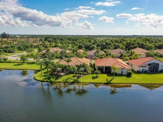 A Spectacular Waterfront Home, with an Awesome Water View, owned by  Seasonal Owners. This Must-See Home, features (3) Bedrooms, 2-1/2 Baths. The Master Bedroom has (2) Large Walk-in Closets w/Upgraded Shelving, adjoining Reading/Office Room.  Bedroom 3 is Opt. Den,  Living Room, Formal Dining Room, Family Room, Crown Molding, Plantation Shutters, Whole House Impact Glass, Screened Lanai. The Home has been Meticulously Maintained, and all Mechanicals have been Upgraded.PLEASE NOTE: ''ALL FURNITURE, TV'S,  AND ACCESSORIES CAN BE PURCHASED IN A SEPARATE TRANSACTION; AS A TURNKEY PACKAGE''. CONTAC JIM CECIL ABOUT THE DETAILS.