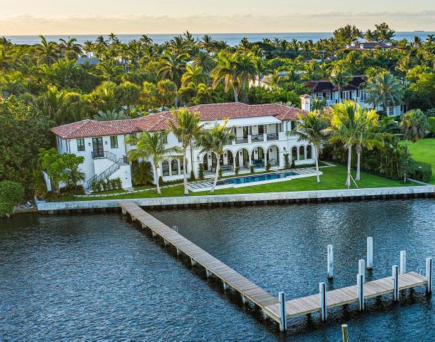 Brand new, fully furnished Estate Section Lakefront on the direct Intracoastal.  Designer furnished with unprecedented attention to detail that highlights this spectacular waterfront location.  Designed for quiet & private enjoyment, the home boasts interiors  by noted decorator Marc-Michaels, constructed by Alonso & Assoc.  Magnificent sunsets and water views are enjoyed from virtually every room  & from every vantage point.   Over 155 ft. of water frontage with  a new dock.   Amenities include: glass wine cellar, fireplace, elevator, 2nd level covered balcony, outdoor shower, 2 laundry centers, 5 AC zones, security system, full house generator, hurricane impact throughout, 2-car AC garage w/guest suite above with separate entrance, 40 ft.  pool with sun-shelf and spa. DISCLAIMER: The written and verbal information provided including but not limited to prices, measurements, square footages, lot sizes, calculations and statistics have been obtained and conveyed from third parties such as the applicable Multiple Listing Service, public records as well as other sources. All information including that produced by the Sellers or Listing Company are subject to errors, omissions or changes without notice and should be independently verified by any prospect for the purchase of a Property.  The Sellers and Listing Company expressly disclaim any warranty or representation regarding all information.  Prospective purchasers' use of this or any written and verbal information is acknowledgement of this disclaimer and that Prospects shall perform their own due diligence.  Prospective purchasers shall not rely on any written or verbal information provided when entering a contract for sale and purchase.  Some affiliations may not be applicable to certain geographic areas. If your property is currently listed with another agent, please do not consider this a solicitation for the listing. In the event a Buyer defaults, no commission will be paid to either Broker on the Deposits retai