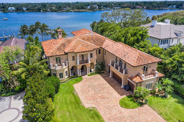Boasting over a 100 feet of water-frontage and incredible panoramic views of the Loxahatchee River, this grand estate is a true master piece.  Set on one acre of land and located on the sought after Pennock Point Road, this  8,500+ sq. ft. home, built by Ecclestone Signature Homes, truly displays craftsmanship and attention to detail.  Upon entering you will be drawn in by the water views.  The home is a perfect combination of formal and informal living.  The formal dining area, leading into the living room along with the wine storage lend for that elegant formal event.  The open kitchen to the family room, breakfast room and summer kitchen allow for that comfortable casual living. The master bedroom, with his and her  bathrooms, has amazing views, including the famed Jupiter Lighthouse.