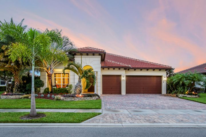OPEN HOUSE SUNDAY, MAY 17th 1-3PM! Gorgeous Rialto home! Enjoy 4 beds, 3 baths & 3 car garage w/ new 40x20 pool & Tiki hut on an Estate Lot overlooking the lake! This is a rare combination & is ready for new owners! This highly desirable model offers a fantastic 3 way split floor plan, is bright, sunny & immaculately clean. The outdoor living area offers the FL lifestyle dream! Enjoy a heater/chiller for pool, beautiful lighting & a tiki hut big enough to seat 20 ppl! Marble pavers, lovely view of the lake & beautiful landscaping make this the perfect addition to your usable living space. Rialto is a gated community with incredible amenities, resort style pool, fitness center, multi courts & onsite management. A rated schools & access to beach, marinas, golf, 95/Turnpike & PBI airport make this one not to miss!