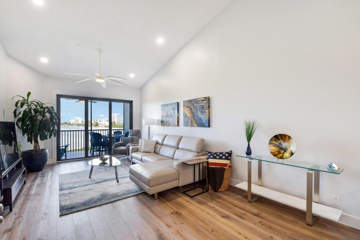 A wow living space starts with soaring ceilings, high end finishes and an incredible water view!