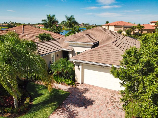 ABSOLUTELY PERFECT! You've finally found the one.. Located  a few steps from the spectacular community clubhouse and putting green this 4 bed/4 bath beauty w/2 master suites in vibrant 55+ Vitalia at Tradition has it all. The huge screened lanai with a 15' by 30' salt chlorinated pool and spa is your own private paradise.The wide open floor plan featuring 24'' tile on diagonal and a huge cook's island is perfect for entertaining. The gourmet kitchen boasts granite counters, beautifully finished 42'' cabinets, dbl. wall ovens, gas cooktop and more. Each master suite features walk in closets, dbl. vanities a view of the pool/spa and the lake beyond. Other upgrades include a barrel tile roof, impact windows and doors, top of the line appliances, lush landscaping, and designer finishes.
