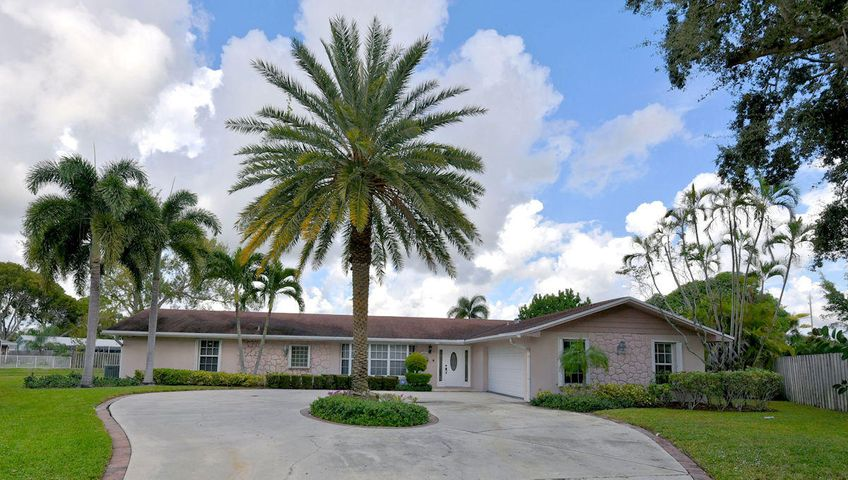 Newly updated single family home on .38 of an acre in the heart of Palm Beach Gardens. This home offers tons of living space with new wood tile floors and a new kitchen. This home has a formal living room, family room, formal dining room, an office / nursery attached to the master suite, and a mother in law suite serving as your 4th bedroom. The master suite is spacious with large walk in closet, separate shower and tub, dual sink vanity, extra closet space in the bathroom, and an attached office area. Across the house from the master suite is your 2nd and 3rd bedrooms sharing your 2nd bathroom. Your 4th bedroom / mother in law suite is equipped with a wet bar, mini refrigerator, private bathroom with large handicap walk in or roll in shower for wheelchairs. There is also a private door to the patio and pool area. Other features of this home include: a sizeable kitchen offering plenty of cabinet storage and pass through window, large covered patio area with screened in pool, fenced backyard with gym set, large side yard, security system which a tenant may choose to have monitored, accordion shutters and panels for the living room bay window. This home is located on a quiet u-shaped street, tucked back into a small cul de sac. Rental amount includes monthly landscaping, pool service and annual pest control service.