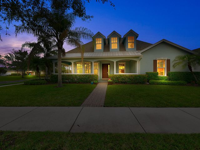 Own a piece of paradise with this 3 bedroom and 2.5 bath home located in Bedford Park at Tradition! This home features beautiful finishes throughout including pergo wood plank laminate flooring in the main living areas, a large covered porch, a den/office, and a spacious family room. The tastefully appointed kitchen is complete with white cabinets, stainless appliances, and a large cook island and counter. Enjoy the large fenced backyard with friends and family, a perfect spot for even the largest of gatherings or outdoor activities. Bedford Park offers its residents great amenities such as a clubhouse with a pool and beautiful lush green spaces. Tradition is a master-planned community that looks and feels like the towns of yesterday with its beautiful lakes, vistas, great recreation