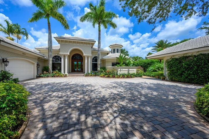 This beautiful waterfront home is a piece of Florida paradise! This home includes marble tile floors, a gas and wood burning fireplace, coffered and tray ceilings throughout, an exquisite gourmet kitchen with quartz and granite counters, a gorgeous one of a kind agate wall, upgraded fixtures and a gas heated infinity pool. This home is the entertainer's dream with a guest cottage, spacious living areas, a sunken wet bar, a large outdoor space with bar and DCS grill, lush tropical landscaping and two boat lifts. Also includes air conditioned garage/workshop and a den. This home has been extensively and lavishly upgraded just last year! Just a 20 minute boat ride to the Jupiter inlet. Call us today to set up your viewing of this beautiful home!