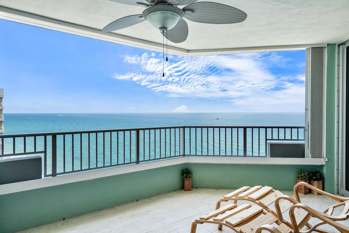 Enjoy the Cool Ocean Breeze from your beachfront balcony with ocean and intracoastal views, the balcony is larger than most, you can put an outside eating and sitting area. This 2 bedroom condo is light and bright with impact windows and & doors, wood floors in the living areas, white kitchen cabinets, washer and dryer in the unit. Both bedrooms have there own bathroom and each with a walk in closet. Amenities include private estate-like setting, beautiful new garden area, a spacious newly renovated ocean front pool deck and summer kitchen, full size tennis court, two card rooms, billiards room, exercise rooms with his and her saunas, custom designed ocean view owner's lounge equipped with bar and kitchen. The building has 24 hour concierge and gated garage parking.