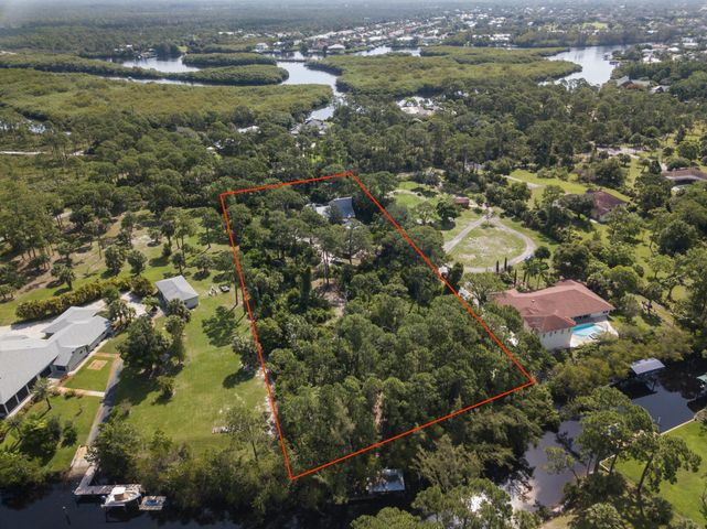 Serenity abounds on this 2.55 acre waterfront property nestled in Jupiter's only equestrian waterfront neighborhood. A charming rustic four bedroom home with separate 1500 sf garage (with lift) in addition to a two car garage. Both river and ocean access from your private dock. Breathtaking nature surrounds with deer, manatee and more.  10,000 acres of Jonathan Dickinson State Park practically in your backyard.With nearly 40 miles and multiple rivers, the Jupiter Waterway carves out a natural playground of beaches, crystal-clear inlets and lush coastal rivers.  You will love to call Jupiter your home!