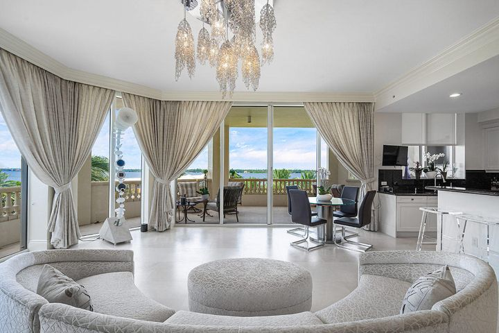 The Best Priced Residence in Bellaria! You'll enter this magnificent apartment from your private keyed elevator. Inside this impressive corner residence you have breathtaking Intracoastal and sunset views, soaring 10-ft+ ceilings, spectacular light marble floors, electronic shades, floor-to-ceiling impact glass, custom closets and a reconfigured marble master bath with steam shower. The newly remodeled open kitchen features modern lighting, stone countertops, professional grade Thermador gas range, and Sub-zero wine refrigerator. Exceptional first class amenities in this pet-friendly full-service building include 2 car garage parking, fitness center, home theater, billiards room, club room, private beach access, 24/7 manned gate and on-site concierge, pool & beach attendant. Two Flat Screen Televisions will remain - The Kitchen and the Guest Bedroom. The 3rd Bedroom/Den and Balcony Television are excluded. All the door hinges and locks have been replaces with Baldwin hardware and the Cabinets have Deltana and Emtek hardware. Bath fixtures are Brizo, Delta's higher end line.