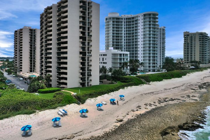 Located on Singer Island this 2 bedroom, 2 bathroom corner unit has two balconies, one to watch the sunrise over the Atlantic Ocean, and one to watch the sunset over the Intracoastal waterway and heart of Palm Beach County. This immaculate and spacious condominium is move in ready with fresh paint, custom kitchen cabinetry, granite countertops, full sized laundry room, tile flooring and impact windows and sliders throughout. The newly remodeled Cote D' Azur is an ocean front property that offers a large pool area, covered pavilion, 2 tennis courts, pickleball, gym, sauna, meeting rooms, newly renovated hallways and lobbies with secured gated entry & manager on site. Singer Island boasts some of Florida's finest beaches and offers a relaxed lifestyle with the option of an active nightlife. With close proximity to The Palm Beach International Airport, Palm Beach Gardens Mall and numerous restaurants this location can not be beat!!!