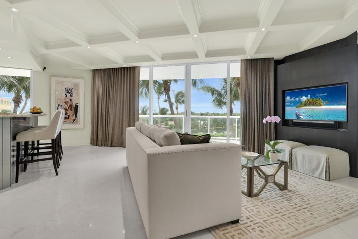 An Extraordinary Residence with an Elegant Flair.  Exquisite Designer Details through-out: Coffered Ceilings & Custom Moldings, LED Recessed Lighting, Custom Built-in Flat Screen Creations and Stunning Bar & Wine Cabinet. Unique Wall Paneling & Subtle Wall Paper. Stylish Chandeliers and gorgeous light fixtures, Designer Drapes, some Electrified. Gorgeous High-end Furnishings are negotiable. Marble and Wood flooring, Stainless Steel Subzero and Bosch  Appliances Washer/Dryer & Air Conditioner have been replaced.  Hurricane Impact Sliding Glass Doors throughout Enormous Balcony and 2 garage parking spots side by side. Reside in this lovely home all with The Ritz-Carlton Residences 5 Star Amenities!! First Class Services include: Concierge, Valet Parking, Guard Gate Security and Surveillance Cameras, On Site Management, 2 Resort Style Heated Pools, 2 Jacuzzi, Grill Room Restaurant and Barbecues, 2 Recreational Rooms, State of the art Fitness Rooms, Billiards, Card and Theater Rooms.  PLUS 375 feet Private Beach!
