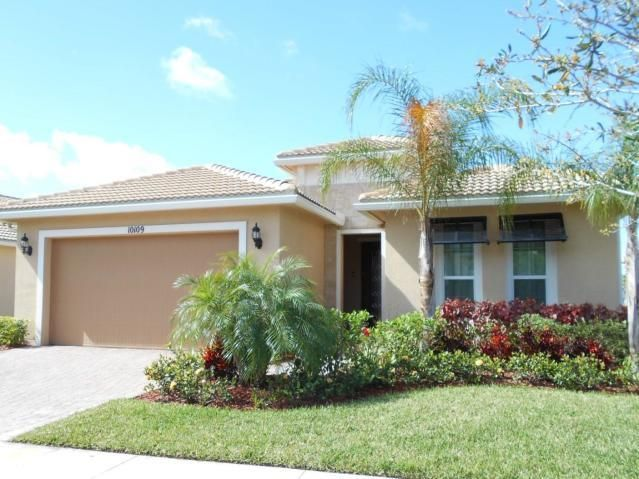 Mrs. Clean lives here!!!  Vitalia 55+ newer guard gated community. Beautiful award winning Lauderdale model with 2 bedrooms plus a den all on a lake with long lake views. OPEN CONCEPT GREAT ROOM.  Upgrades include impact windows thru out, LARGE extended and screened lanai, all tile floors on diaginal, tile roof and much, much more.  Community offers 2 heated pools and hot tub, gym, ballroom, full time manager and lifestyle manager and too many amenities to mention.