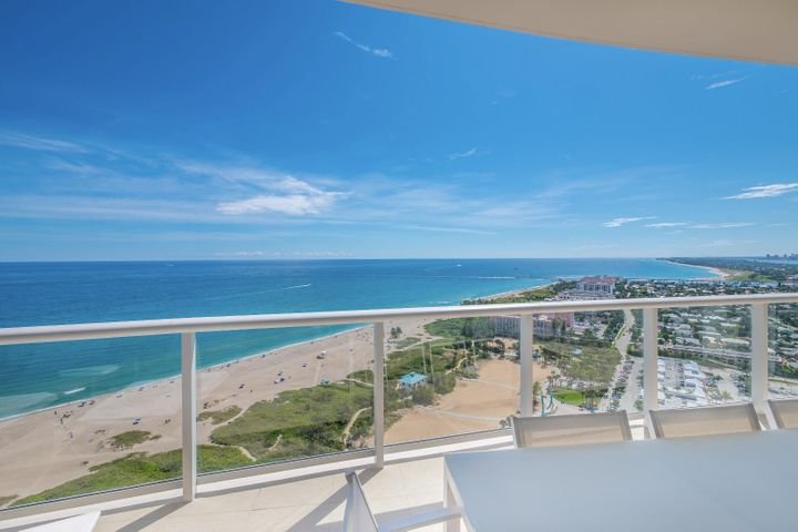 Welcome to the Ritz Carlton Residences , where you will find stunning views from this penthouse unit.. Beautiful sunrises, only steps to the beach and the aqua blue ocean waters. This delightful condo includes 3 large light filled bedrooms, with ensuite bathrooms,  Open kitchen with top of the line appliances. Dining area overlooking the ocean. 2 covered car spaces and a large air conditioned  storage unit. Tastefully finished interiors.. Ritz classic services; valet, 24 hr. concierge & security, Private restaurant with pool service, media room, social room, fabulous fitness center, towel service, beach chair service. Two heated pools and spas. Two dog walks. It is all here at the Ritz. Come and enjoy the lifestyle , You DESERVE IT!