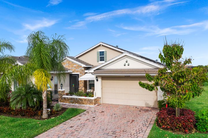 This home has a video tour. Stunning and perfect is this Key Largo Model home in the active 55+ community of Vitalia located at Tradition. Situated on an Estate Lot overlooking the water this home boasts two master suites with custom walk in closets, dbl sinks, large glass shower enclosures, and one with Jacuzzi tub. The spacious open floor plan allows plenty of room for entertaining family and guests.  The custom pool with spa measures 14x28.  This home feature a gourmet kitchen with gas stove,  quartz counter tops, Media Room, custom built in shelving, Hunter Douglas shades, and guest house Casita with one bedroom and bath. Washer/ Dryer and gas grill convey with property. This is a must see one of a kind  4 bedroom 4 bath home nestled close to the Clubhouse and club amenities.