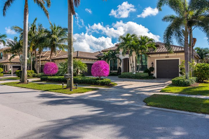 Stunning, open, & bright lake view estate home w/south exposure. Professionally designed w/over $1M in upgrades: built-ins, mirrors, window treatments, lighting/fan fixtures, wallpaper, & appliances. Entire home has porcelain tile (approx 32'' sq ft) floors. Living room has floor to ceiling white stone fireplace. 3 A/C units w/HVAC air purification/disinfection systems.3M Suncontrol film for UV/Heat reduction. Magnificent designed mirrored foyer w/inlaid entry designed floor. Upgraded gas kitchen, formal dining rm, game rm, 4 bedrooms w/ baths, custom office, wet bar, closet systems & crown molding thru-out, central vac system. Safe on premise. Large patio w/upgraded gas summer kitchen. Heated salt-water pool/spa w/Jandy automatic pool control system. MUST SEE TO APPRECIATE THE QUALITY!